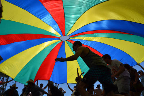 4-14-12(Daily Breeze Photo by Douglas Morino Staff Reporter) Fans dance underneath a parachute at Coachella on Friday.